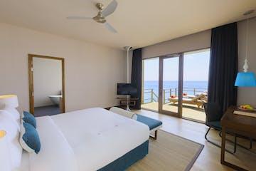 Bed view - Water villa, Dhigali Maldives